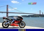 Production (Stock) Aprilia RS Models, a Aprilia RS250 parked on a bridge over a body of water