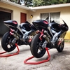 Production (Stock) Aprilia RS Models, a red and black Aprilia RS250 parked in front of a house