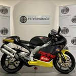 Production (Stock) Aprilia RS Models, a motorcycle parked on the side a Aprilia RS Models Sportbike parked on the side