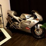 Production (Stock) Aprilia RS Models, a motorcycle parked on the side of the room a Aprilia RS Models Sportbike parked on the side of the room