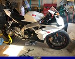 Production (Stock) Aprilia RSV4/RSV4R, a fighter jet sitting on top of a Aprilia RSV4/RSV4R sportbike
