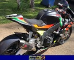 Production (Custom) Aprilia RSV4/RSV4R, a motorcycle parked on the side of a road a Aprilia RSV4/RSV4R Sportbike parked on the side of a road