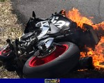 Crash Aprilia RSV4/RSV4R, a motorcycle that is on fire a Aprilia RSV4/RSV4R Sportbike that is on fire