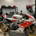 Production (Stock) Aprilia RSV4/RSV4R, a motorcycle parked on the side of the road a Aprilia RSV4/RSV4R Sportbike parked on the side of the road