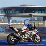 Production (Stock) BMW S1000RR, A photo of a 2020 BMW S1000RR Sportbike. a person riding on the back of a 2020 BMW S1000RR Sportbike