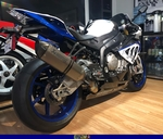 Production (Stock) BMW S1000RR, a motorcycle parked on display in a room a BMW S1000RR Sportbike parked on display in a room