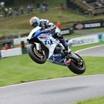 Stunts BMW S1000RR, a person riding a motorcycle on a track a person riding a BMW S1000RR Sportbike on a track