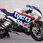 Production (Stock) BMW S1000RR, a person riding on the back of a motorcycle a person riding on the back of a BMW S1000RR Sportbike