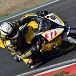 Misc. Racing BMW S1000RR, a person riding a motorcycle on a track a person riding a BMW S1000RR Sportbike on a track
