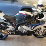Production (Stock) BMW S1000RR, a motorcycle is parked on the beach a BMW S1000RR Sportbike is parked on the beach