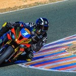 Misc. Racing BMW S1000RR, a person lying on a blue motorcycle a person lying on a blue BMW S1000RR Sportbike
