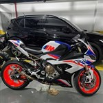 Production (Stock) BMW S1000RR, a motorcycle parked in a parking lot a BMW S1000RR Sportbike parked in a parking lot