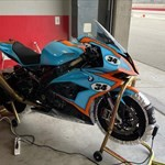 Production (Stock) BMW S1000RR, a motorcycle parked on the side of a building