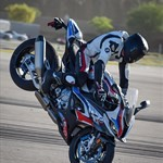 Stunts BMW S1000RR, a group of people riding on the back of a motorcycle