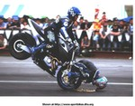 Stunts Buell XB Models, Craig Jones wins European Motorcycle Stunt Championship with this one crazy stoppie... The poor guy scraping his head is Wing Chui