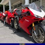 Production (Stock) Ducati 1098/1198, a red motorcycle parked on the side of a building a red Ducati 1098/1198 Sportbike parked on the side of a building