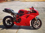 Production (Stock) Ducati 1098/1198, a red motorcycle parked on a dirt road a red Ducati 1098/1198 Sportbike parked on a dirt road