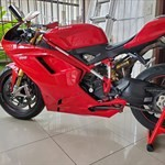 Production (Stock) Ducati 1098/1198, a red and black motorcycle is parked on the side of a building a red and black Ducati 1098/1198 Sportbike is parked on the side of a building