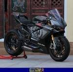 Production (Stock) Ducati 1199/1299 Panigale, a Ducati 1199/1299 Panigale sportbike parked in front of a building