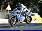 Misc. Racing Ducati 851/888 Superbike, a man riding on the back of a motorcycle a man riding on the back of a Ducati 851/888 Superbike Sportbike a man riding on a Ducati 851/888 Superbike Sportbike