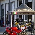 Production (Stock) Ducati 851/888 Superbike, a red and black motorcycle parked on the side of a building a red and black Ducati 851/888 Superbike Sportbike parked on the side of a building