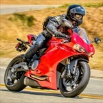 Production (Stock) Ducati 899/959 Models, a man riding a motorcycle down a dirt road a man riding a Ducati 899 Sportbike down a dirt road