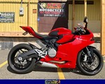 Production (Stock) Ducati 899/959 Models, a red and black motorcycle parked on the side of a building a red and black Ducati 899 Sportbike parked on the side of a building