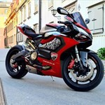 Production (Custom) Ducati 899/959 Models, a red and black motorcycle is parked on the side of a building a red and black Ducati 899/959 Models Sportbike is parked on the side of a building