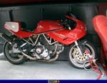 Production (Stock) Ducati 900cc Models, a red Ducati 900cc Models parked in front of a building