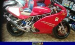 Production (Stock) Ducati 900cc Models, a red Ducati 900cc Models parked in a room