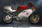 Production (Stock) Ducati 900cc Models, Ducati 900cc Models 23667.jpg a red and black Ducati 900cc Models Sportbike is parked on the side