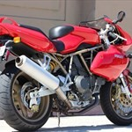 Production (Stock) Ducati 900cc Models, a motorcycle parked on the side of a building