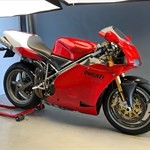 Production (Stock) Ducati 916/996/998, a motorcycle parked on the side a Ducati 916/996/998 Sportbike parked on the side