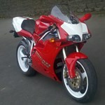 Production (Stock) Ducati 916/996/998, a Ducati 916/996/998 Sportbike parked on the side of a road