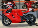 Production (Stock) Ducati Desmosedici, a red and black motorcycle is parked on the side of a road a red and black 2008 Ducati Desmosedici Sportbike is parked on the side of a road