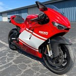 Production (Stock) Ducati Desmosedici, a motorcycle parked on the side of a road a Ducati Desmosedici Sportbike parked on the side of a road