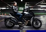 Production (Stock) Ducati Diavel, 2015 DUCATI DIAVEL a 2015 Ducati Diavel sportbike parked on the side of a road