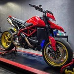 Production (Stock) Ducati Hypermotard, a motorcycle parked on the side