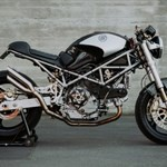 Production (Custom) Ducati Monster Models, a motorcycle parked on the side of a building a Ducati Monster Sportbike parked on the side of a building