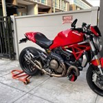 Production (Stock) Ducati Monster Models, a red and black motorcycle is parked on the side of a building a red and black Ducati Monster Models Sportbike is parked on the side of a building