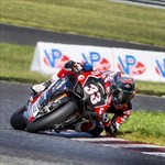 Misc. Racing Ducati Panigale V4, a person riding a motorcycle on a track a person riding a 2019 Ducati Panigale V4 Sportbike on a track