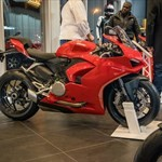 Production (Stock) Ducati Panigale V4, a red motorcycle parked on the side of a road a red 2020 Ducati Panigale V4 Sportbike parked on the side of a road