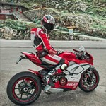 Production (Stock) Ducati Panigale V4, a person riding a red motorcycle a person riding a red Ducati Panigale V4 Sportbike