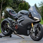 Production (Stock) Ducati Panigale V4, a motorcycle parked on the side of a road a Ducati Panigale V4 Sportbike parked on the side of a road