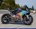 Production (Custom) Ducati Panigale V4, a motorcycle parked on the side of a road a Ducati Panigale V4 Sportbike parked on the side of a road