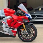 Production (Stock) Ducati Panigale V4, a motorcycle parked on the side of a building a Ducati Panigale V4 Sportbike parked on the side of a building