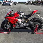 Production (Stock) Ducati Panigale V4, a motorcycle parked in a parking lot a Ducati Panigale V4 Sportbike parked in a parking lot