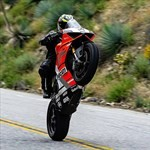 Stunts Ducati Panigale V4, a man riding a motorcycle down a hill a man riding a Ducati Panigale V4 Sportbike down a hill