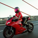 Production (Stock) Ducati Panigale V4, a man riding on the back of a motorcycle