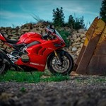 Production (Stock) Ducati Panigale V4, a motorcycle parked on the side of a dirt field